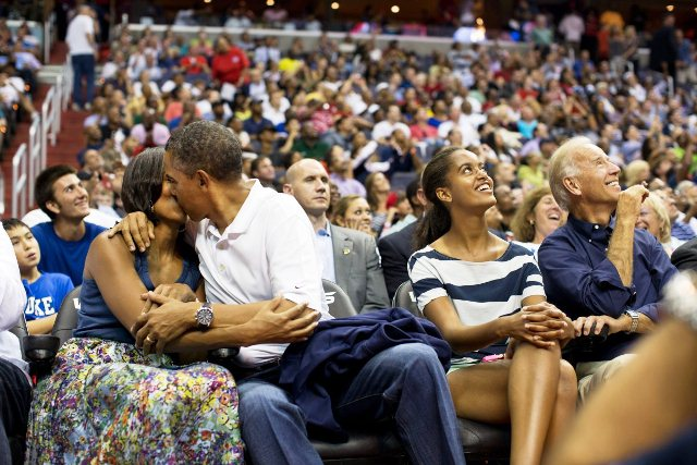 "Barack Obama kisses Michelle Obama for the ""Kiss Cam"" while attending the U.S. Men's Olympic basketball team's game against Brazil at the Verizon Center in Washington, on July 16, 2012."